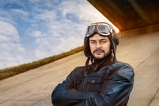 Retro Pilot Portrait with Glasses and Vintage Helmet stock photo