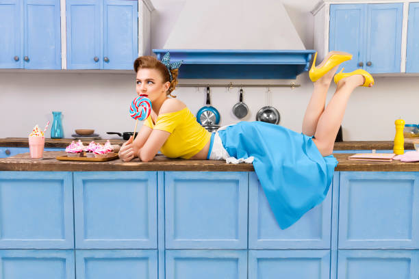 retro pin up housewife on kitchen - gender stereotypes stock pictures, royalty-free photos & images