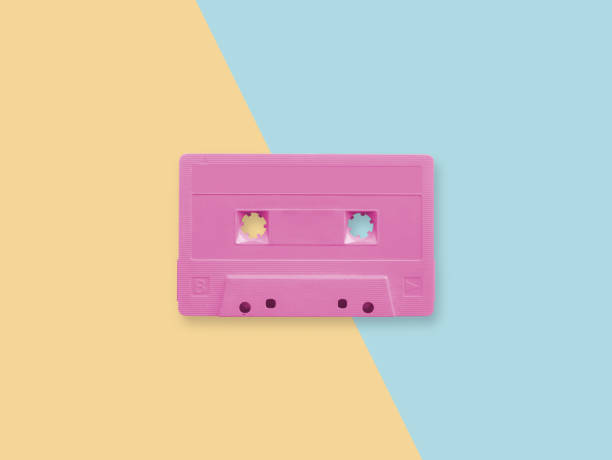 retro rosa kassett band på en pastellfärgad duplexbakgrund - blue yellow band bildbanksfoton och bilder