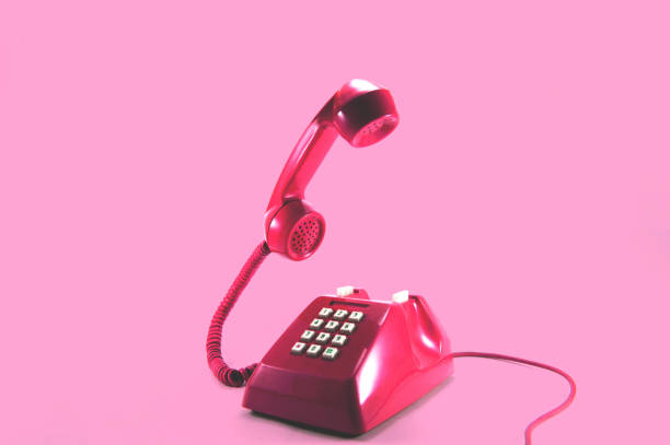 retro pink telephone - pop art stock photos and pictures