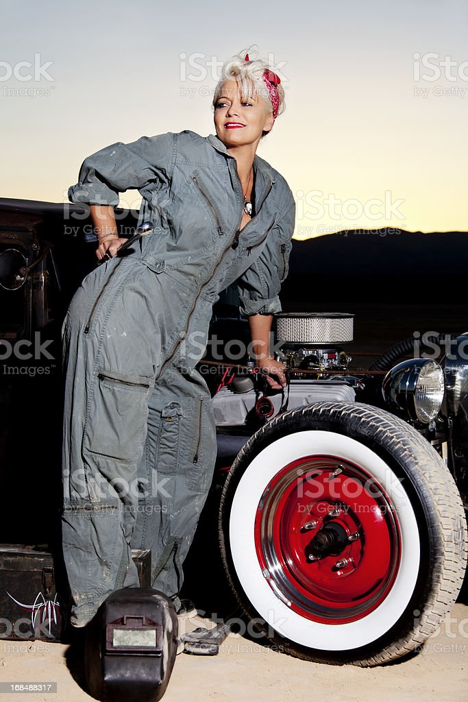 Retro Pinup Girl In Mechanics Coveralls By A Classic Car