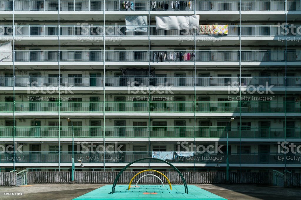 retro playground in front of a colorful old estate stock photo