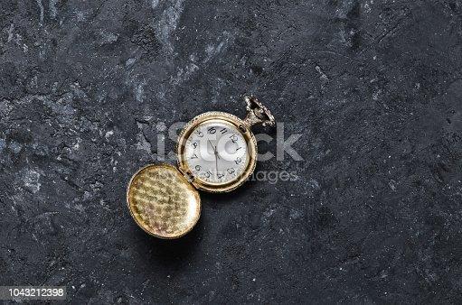 671883446 istock photo Retro pocket watch 1043212398