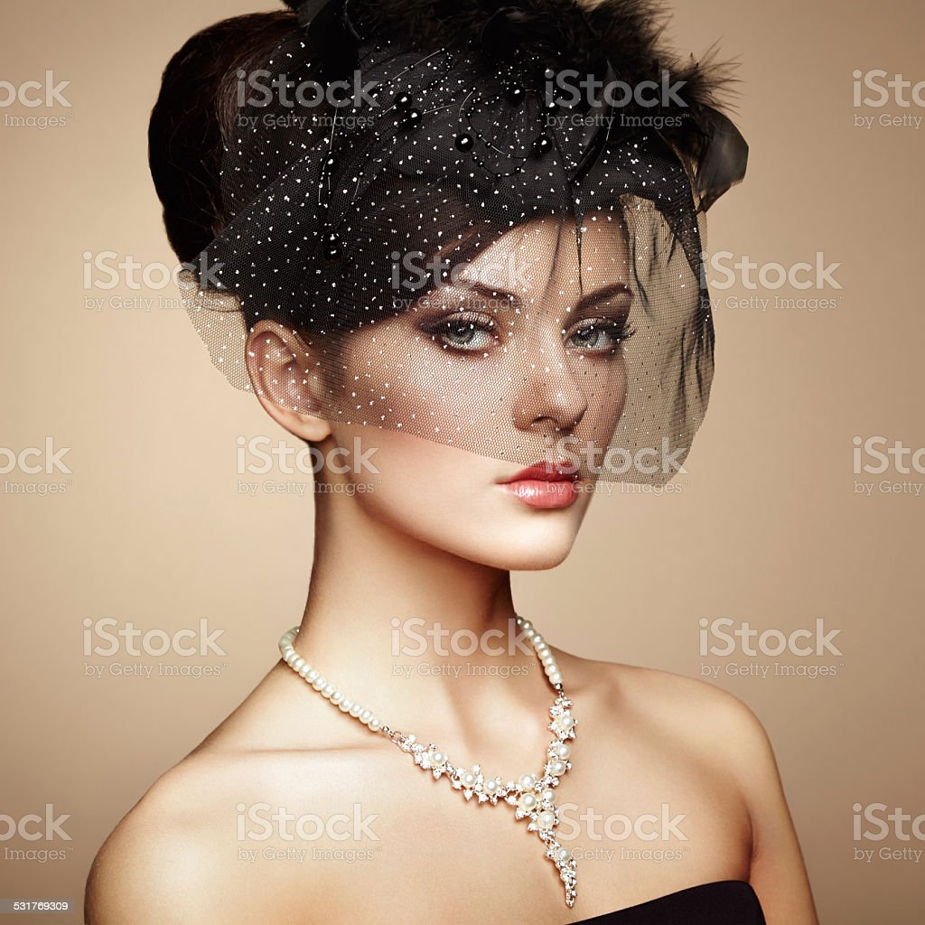 Retro portrait of a beautiful woman. Vintage style stock photo