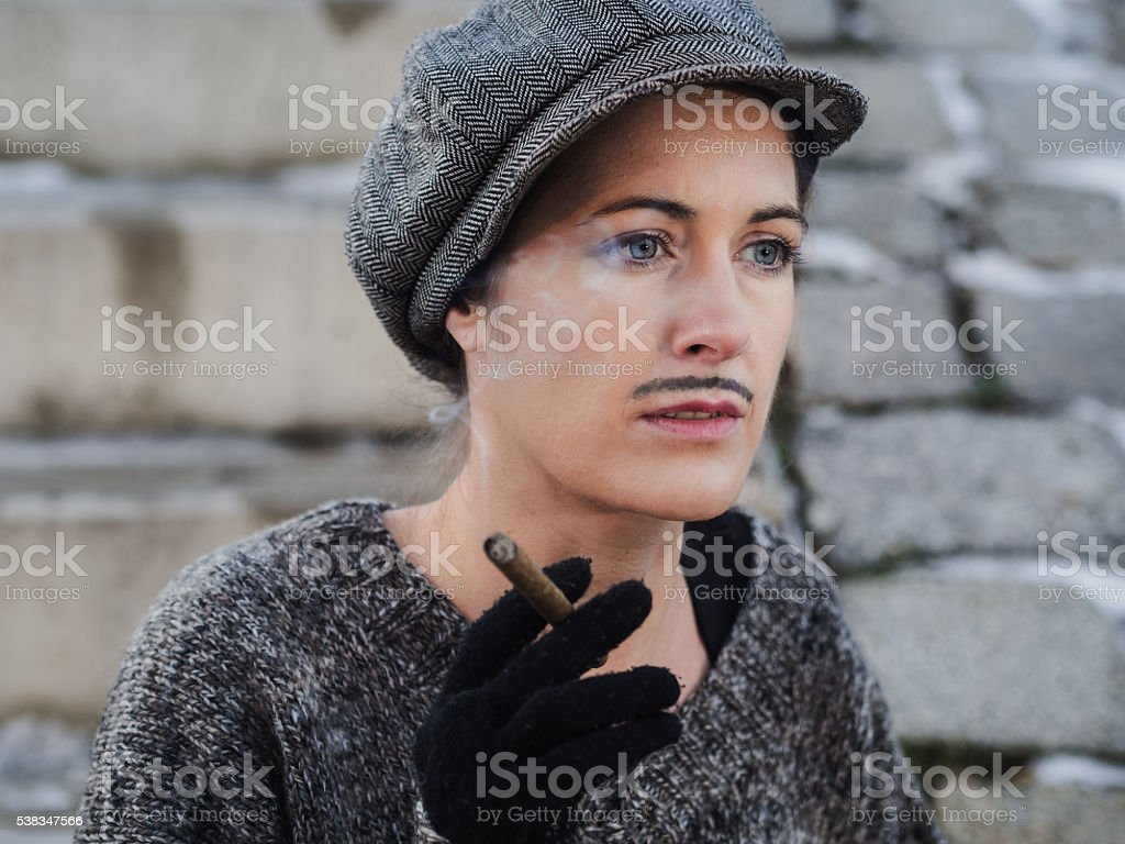 Retro portrait of a serious woman dressed as a man stock photo
