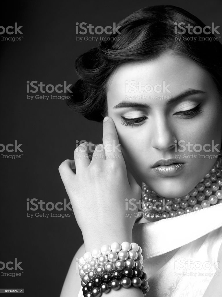 Retro portrait of beautiful woman on a black background royalty-free stock photo