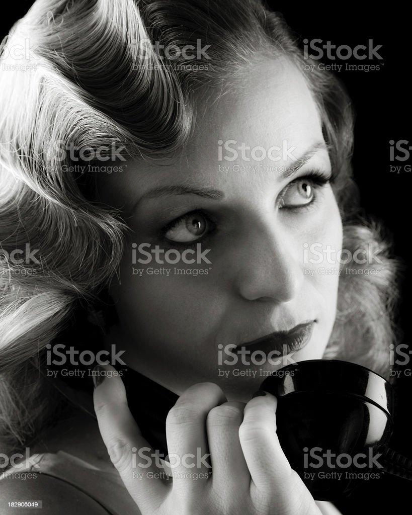 Retro Portrait of Woman on Old Telephone. Film-noir B&W. royalty-free stock photo