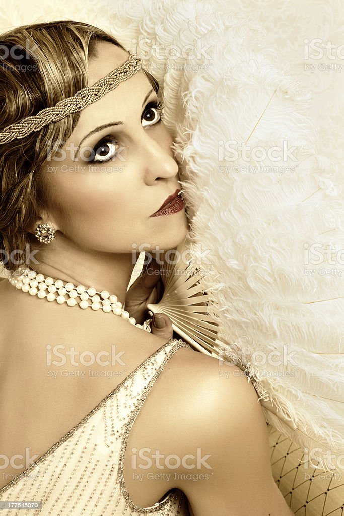 Retro pose with antique fan stock photo