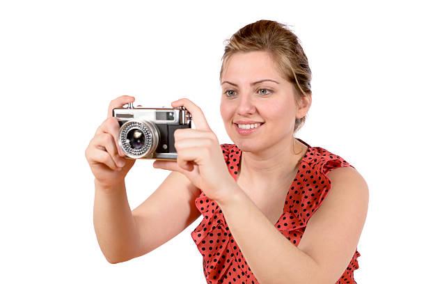 Retro pretty woman photographer stock photo