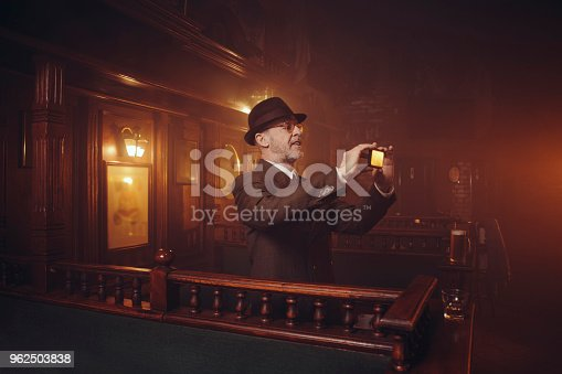 istock Retro pub Old-fashioned lifestyle senior men portrait Active senior using smartphone 962503838
