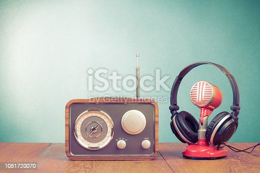 1043737676 istock photo Retro radio, old microphone from 60s and old headphones front mint green background. Vintage instagram style filtered photo 1051720070