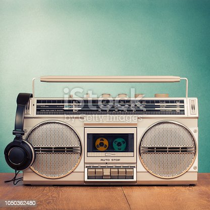 istock Retro radio recorder from 80s and headphones. Vintage old style instagram filtered photo 1050362480