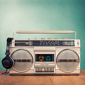 Retro radio recorder from 80s and headphones. Vintage old style instagram filtered photo