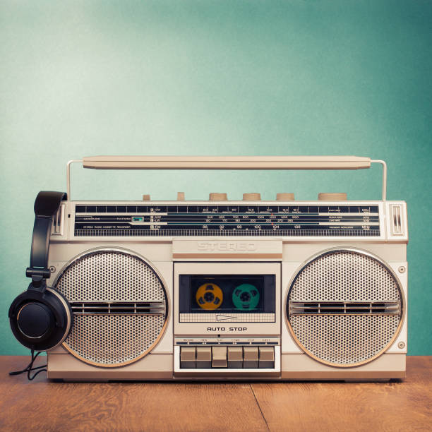 Retro radio recorder from 80s and headphones. Vintage old style instagram filtered photo stock photo