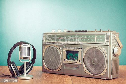 1043737676 istock photo Retro radio recorder from 80s and mic with headphones. Vintage old style instagram filtered photo 1051147556