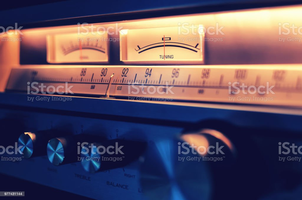 Retro radio tuner receiver with amplifier and FM tuner scale section and tone balance knobs in front panel stock photo
