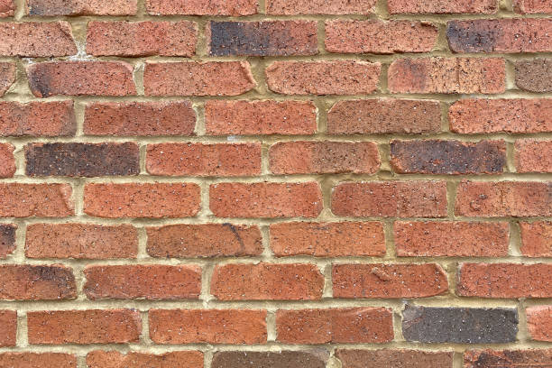 retro red brick sand grout garden wall close-up stock photo