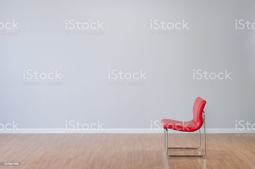 Retro Red Chair In Empty Room royalty-free stock photo