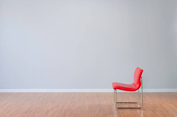 Retro Red Chair In Empty Room Stock Photo