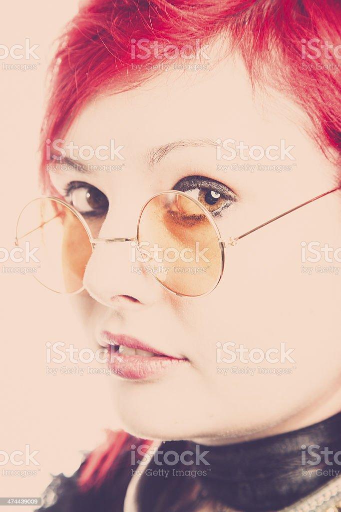 Retro Redhead Wearing Orange Spectacles royalty-free stock photo
