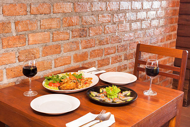 retro restaurant interior with thai food and red wine stock photo