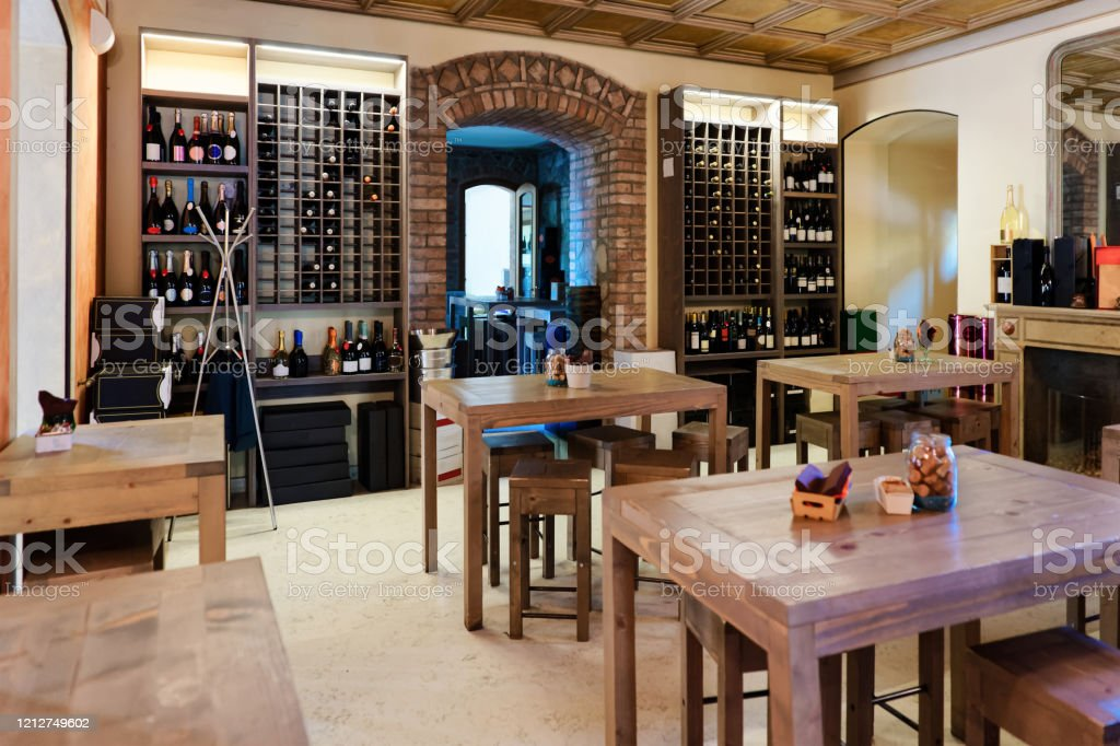 Retro Restaurant Interior With Wine Shelves And Table With Chairs Stock Photo Download Image Now Istock