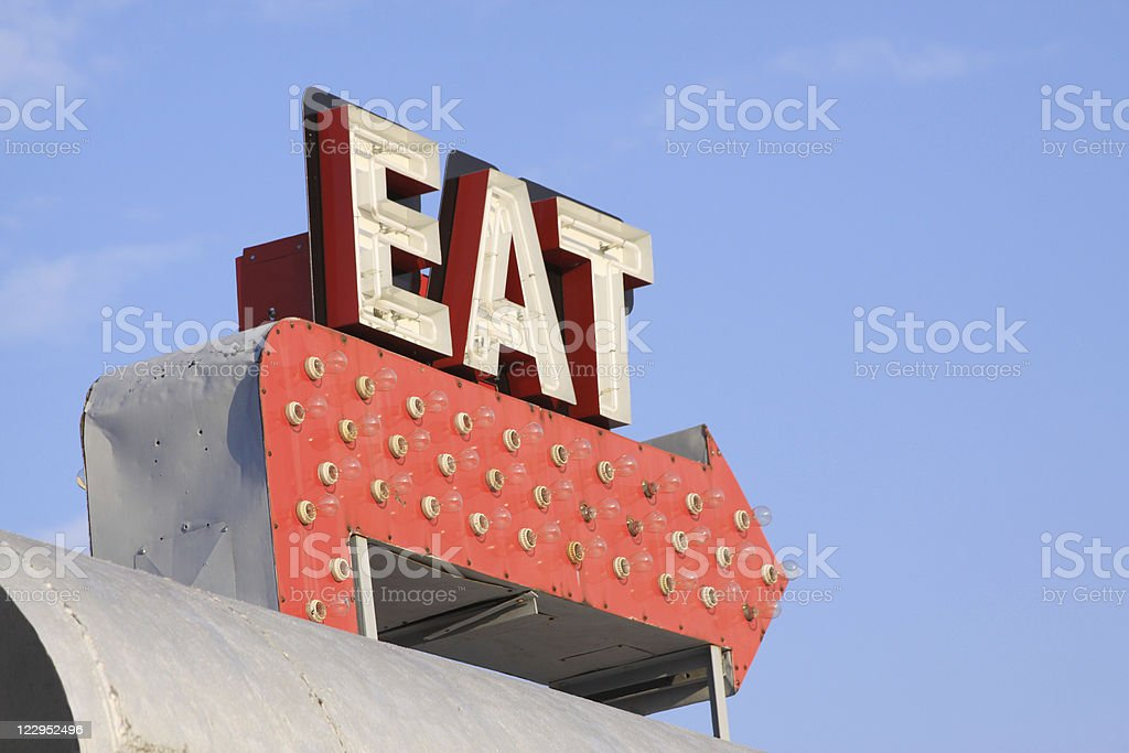 Retro restaurant sign that says EAT on red arrow stock photo