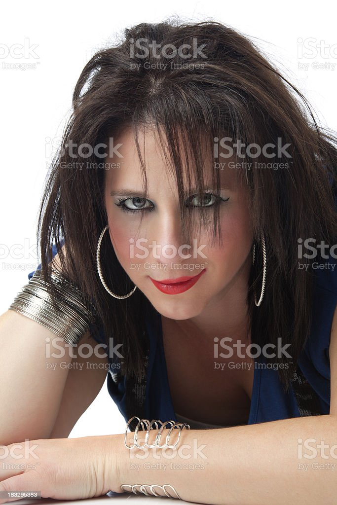 Retro revival: beautiful brunette woman with 80s hairstyle and makeup royalty-free stock photo