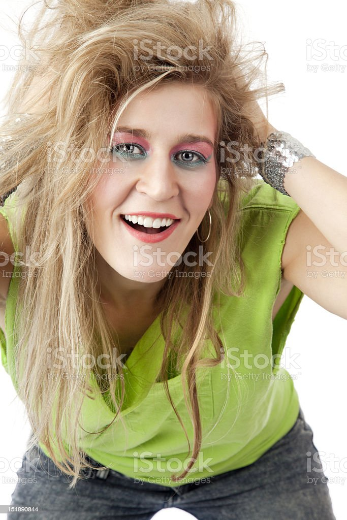 Retro revival: young blond woman with 80s hairstyle and makeup royalty-free stock photo