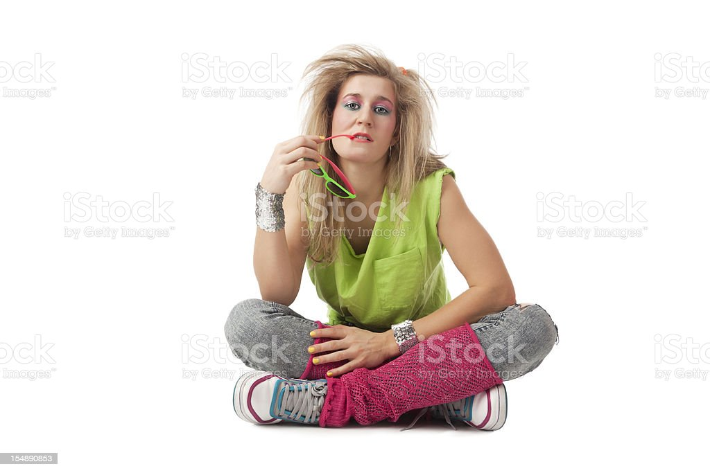 Retro revival: young blond woman with 80s hairstyle and makeup stock photo