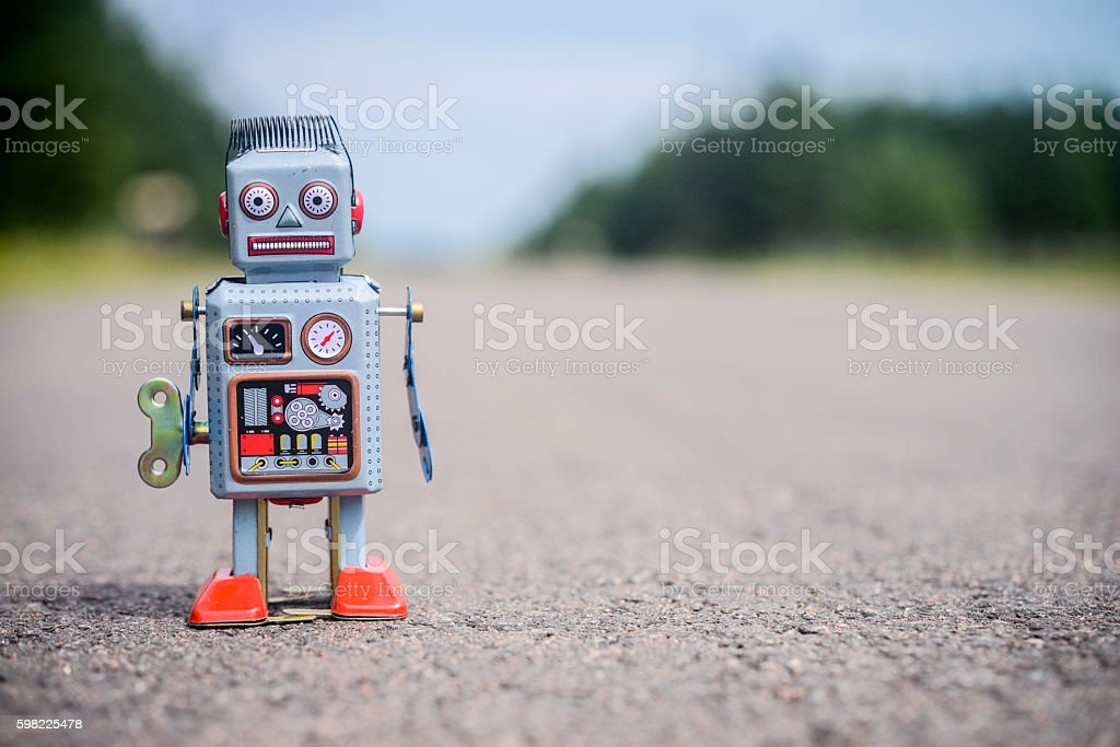 Retro robot on the road stock photo