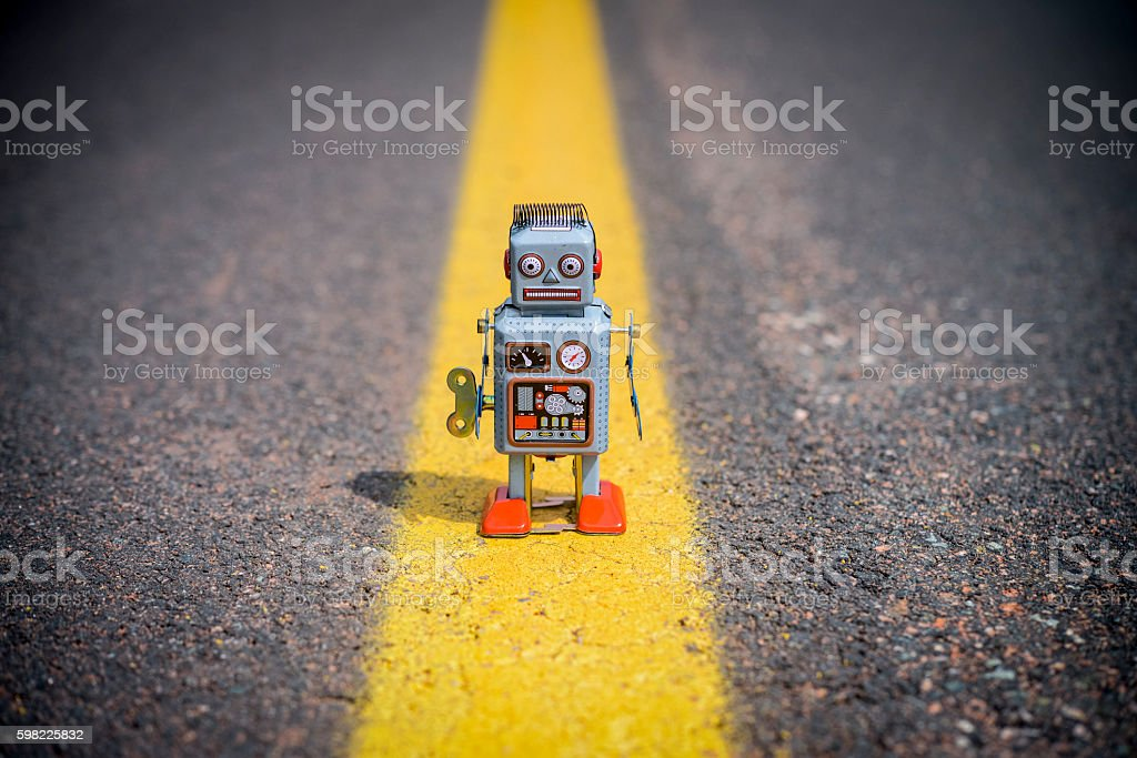 Retro robot on the road foto royalty-free