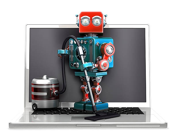 Retro Robot with laptop and vacuum cleaner. Isolated. Clipping path stock photo