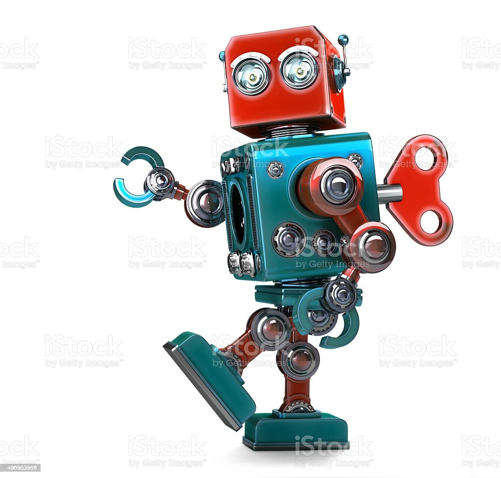 Retro Robot wound up with key. Isolated with clipping path stock photo