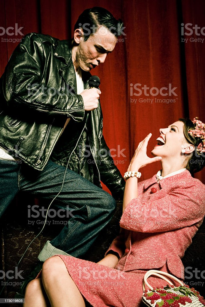 Retro rock star impressing a young woman stock photo