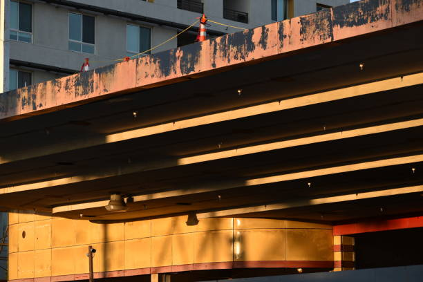 retro roof and facade in late afternoon light - steven harrie stock photos and pictures