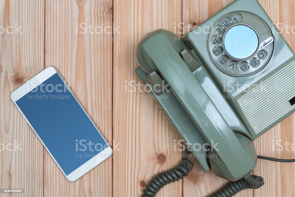Retro rotary telephone or vintage phone with cable and new cell phone...