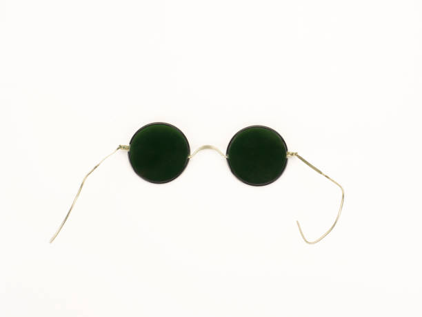 retro rounded sunglasses on isolated white background - sale lenses stock photos and pictures