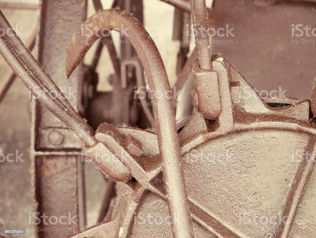 Retro rusted mechanism. Old machinery details closeup. Toned style photo. stock photo