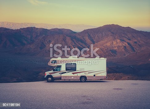 Retro RV Camper In The Californian Desert WIlderness At Sunset