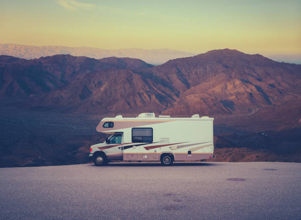 Retro RV Camper In The Desert Retro RV Camper In The Californian Desert WIlderness At Sunset motor home stock pictures, royalty-free photos & images