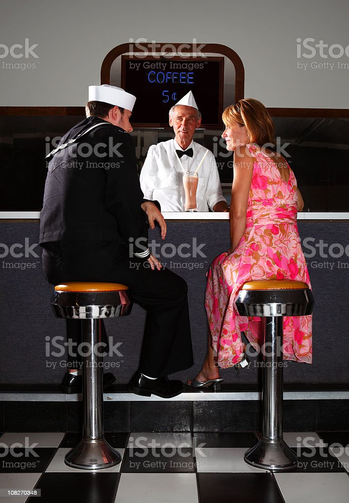 Retro Sailor and Girl at Soda Fountain stock photo