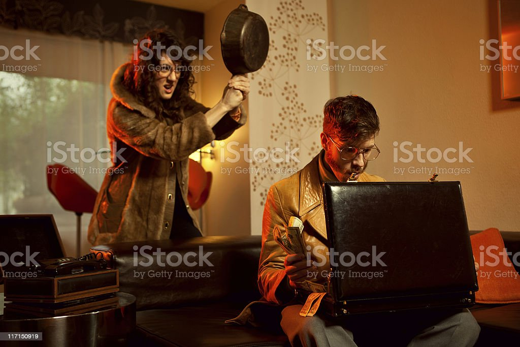 Retro Secret Agent Betrayal with Frying Pan royalty-free stock photo
