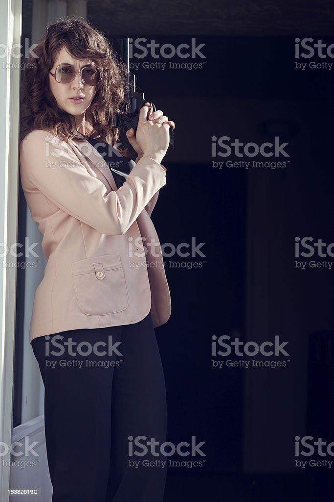 Retro Secret Agent Woman with Pistol stock photo