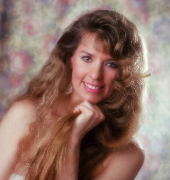 Retro Self-Portrait of a 30-Something Blond Long-haired Woman stock photo