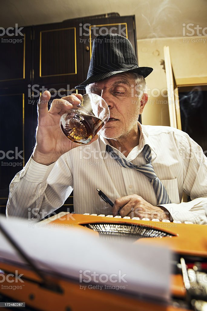 Retro Senior Man writer with a glass of whiskey royalty-free stock photo