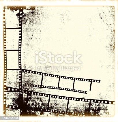 istock Retro sepia film strip frame or background 696285734