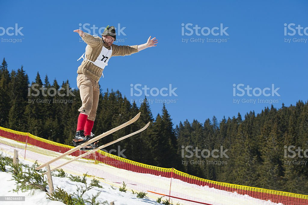 Retro ski jumper in mid-air stock photo
