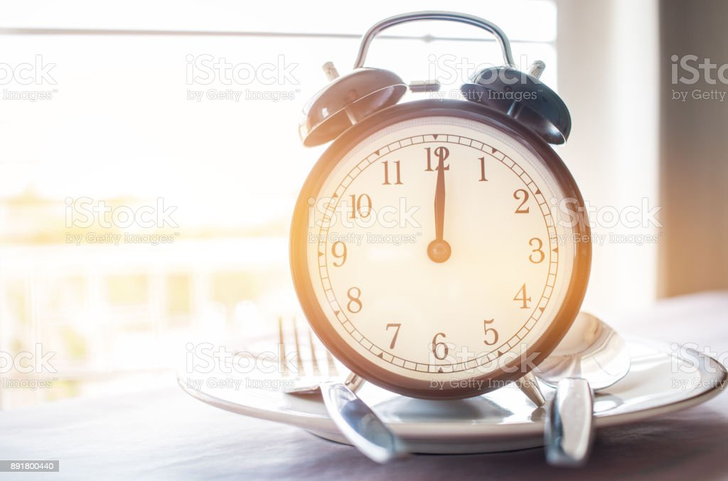Retro stopwatch to put on plate. Weight loss for good Healthy. Diet is sum of food consumed by person or other organism. Lunch Time to diet concept. stock photo