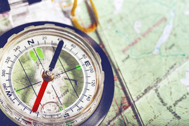 retro style abstract shoot with the compass on a map - wilderness stock pictures, royalty-free photos & images